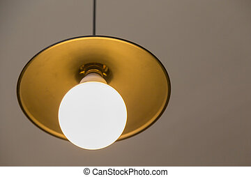 Lamp hanging on a gray wall