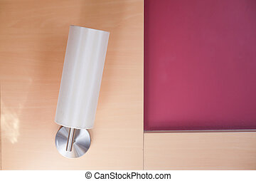Lamp hanging on wood wall