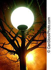 Lamp light - Round street lamp glowing against the ...