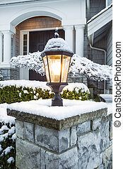 Lamp Ligtht in front of Home with Snow on Top