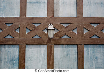 Lamp on a brown lath wall