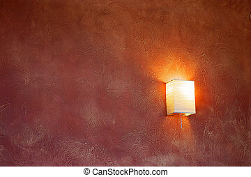Lamp on a claret wall.