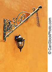 lamp on a orange wall