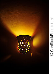 Lamp on a wall shining. Including copy space