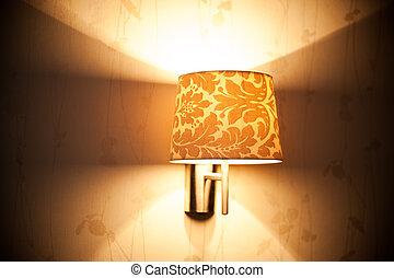 Lamp on a wall shining.