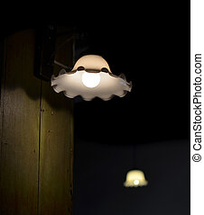 Lamp on a wall shining