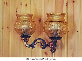 Lamp on a wooden wall in the house
