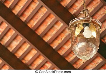 Lamp on ancient wooden roof