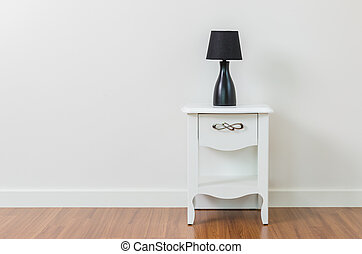 Lamp on bedside table interior room