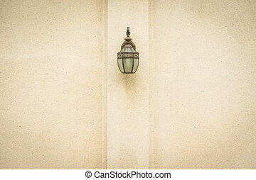 Lamp on brown wall.