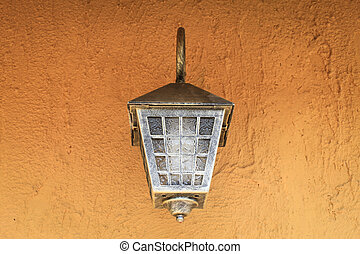 Lamp on brown wall