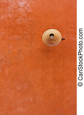 Lamp on red wall
