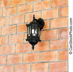 Lamp on texture brick wall