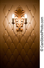 Lamp on vintage tile wall