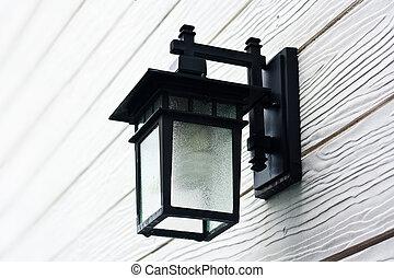 Lamp on white wood background