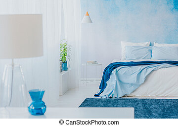 Lamp, vase and bed