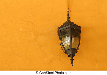Lamp wall on light brown background.