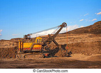 coal-preparation plant. Big yellow mining truck at work site...