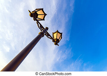Lamppost against the background of the sky with clouds