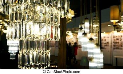 Lamps for sale.  Chandelier in lighting store showroom.