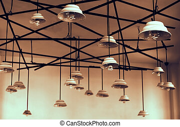 lamps hanging from high ceiling