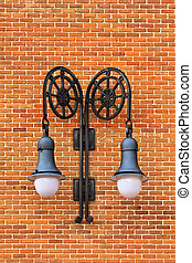 Lamps on red brick wall