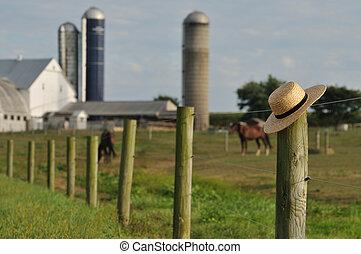 Lancaster Amish farm with straw hat