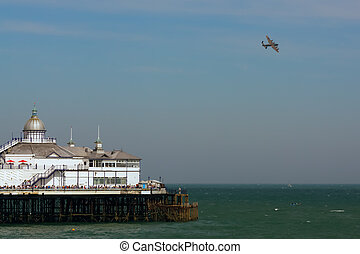 Lancaster flying over Eastbourne Pier