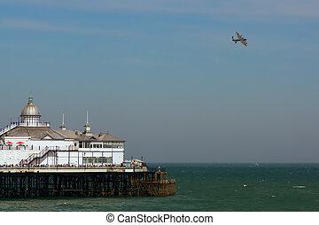 Lancaster flying over Eastbourne Pier