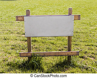 """land for sale - on a lawn is a sign """"building for house for..."""