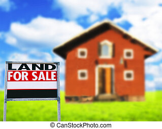 """""""LAND FOR SALE"""" sign against wooden house - Real estate concept"""