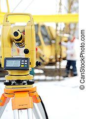 land surveyor theodolite equipment at construction site