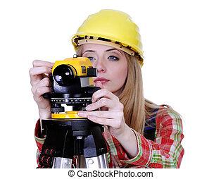 Land surveyor working with theodolite