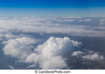 Land view through clouds, aerial photography.