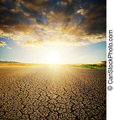 dry cracked ground - land with dry cracked ground