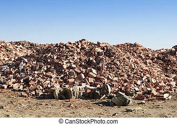 Landfill for disposal of construction waste. Brick debris