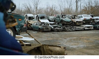 Landfill for vehicles, cars are in a broken state, they do not have glasses and wheels for driving