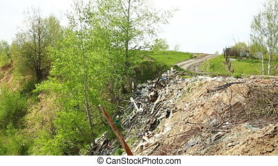 Landfill in city, large amount of garbage dumped on the...