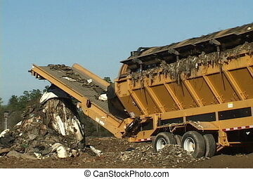 Landfill Screener - Screener separates debris and trash from...
