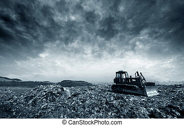 Landfill - Transportation over the daily garbage piled ...