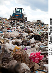 Landfill truck moving garbage - Truck moving garbage in a...