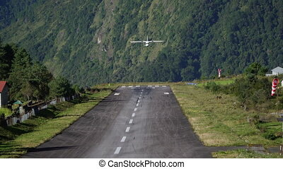 Landing aircraft at Tenzing-Hillary Airport in Lukla