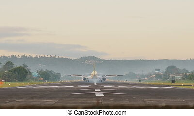 Landing aircraft at the airport of the city of Legazpi early in the morning. Philippines.