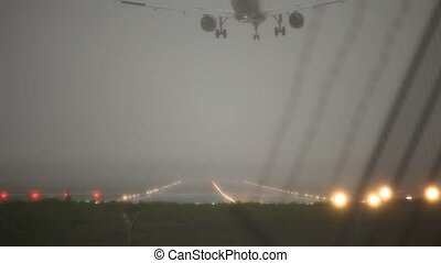 video footage of a windy landing airplane at Hamburg Airport