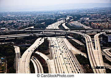 landing at Los Angeles Airport with view to streets and huge crosing of freeway