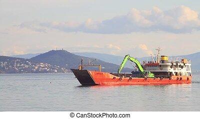 Landing craft with a backhoe loader