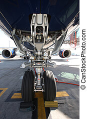 Airplane view from landing gear at airport