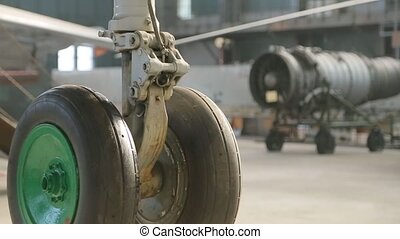 Landing gear of plane close-up.