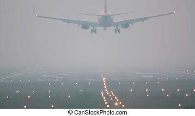 Landing. - jet airplane landing, early morning