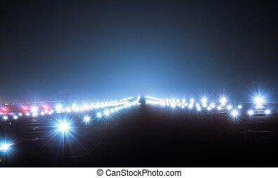 Landing lights at night closeup